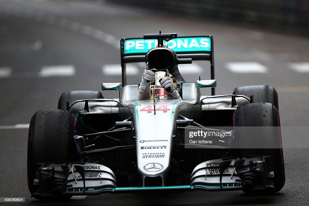 <a gi-track='captionPersonalityLinkClicked' href=/galleries/search?phrase=Lewis+Hamilton+-+Racecar+Driver&family=editorial&specificpeople=586983 ng-click='$event.stopPropagation()'>Lewis Hamilton</a> of Great Britain and Mercedes GP celebrates in the car as he approaches Parc Ferme after winning the Monaco Formula One Grand Prix at Circuit de Monaco on May 29, 2016 in Monte-Carlo, Monaco.