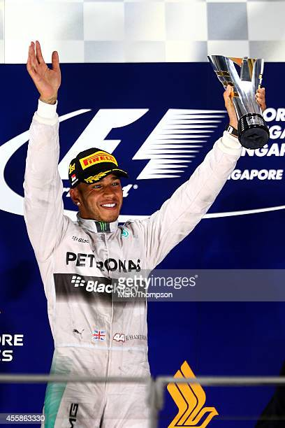 Lewis Hamilton of Great Britain and Mercedes GP celebrates on the podium after winning the Singapore Formula One Grand Prix at Marina Bay Street...