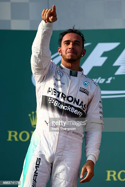 Lewis Hamilton of Great Britain and Mercedes GP celebrates on the podium after winning the Australian Formula One Grand Prix at Albert Park on March...