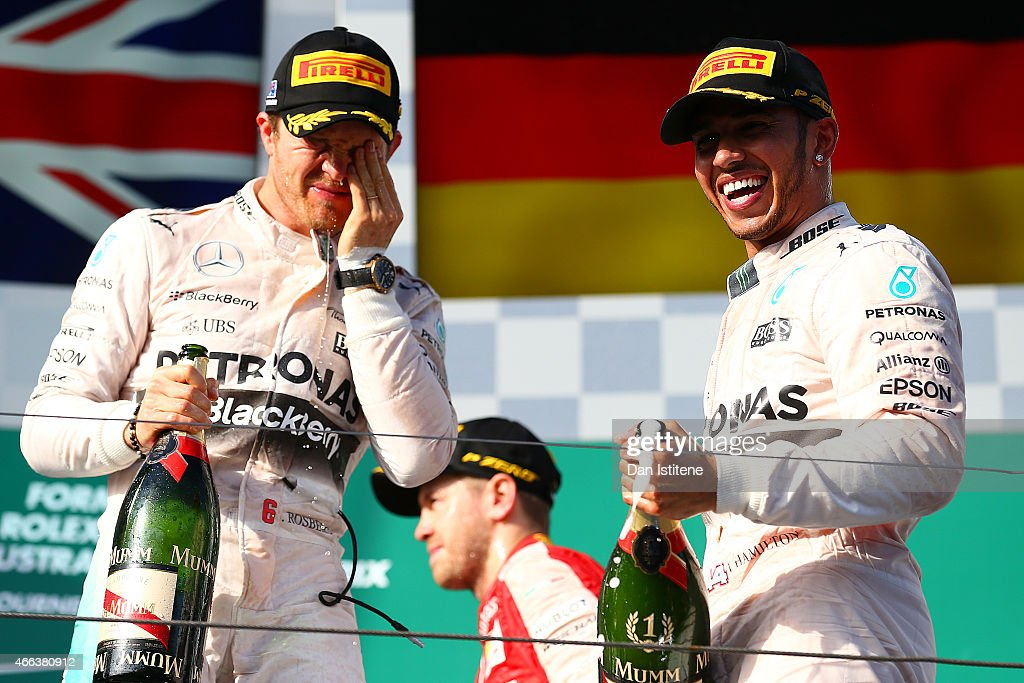 Lewis Hamilton of Great Britain and Mercedes GP celebrates on the podium next to Nico Rosberg of Germany and Mercedes GP after winning the Australian Formula One Grand Prix at Albert Park on March 15, 2015 in Melbourne, Australia.