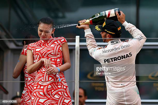 Lewis Hamilton of Great Britain and Mercedes GP celebrates on the podium after winning the Formula One Grand Prix of China at Shanghai International...