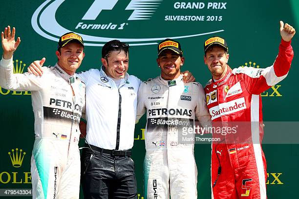 Lewis Hamilton of Great Britain and Mercedes GP celebrates on the podium next to Nico Rosberg of Germany and Mercedes GP and Sebastian Vettel of...