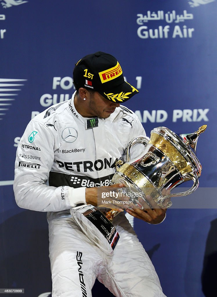 <a gi-track='captionPersonalityLinkClicked' href=/galleries/search?phrase=Lewis+Hamilton+-+Racecar+Driver&family=editorial&specificpeople=586983 ng-click='$event.stopPropagation()'>Lewis Hamilton</a> of Great Britain and Mercedes GP celebrates on the podium after winning the Bahrain Formula One Grand Prix at the Bahrain International Circuit on April 6, 2014 in Sakhir, Bahrain.