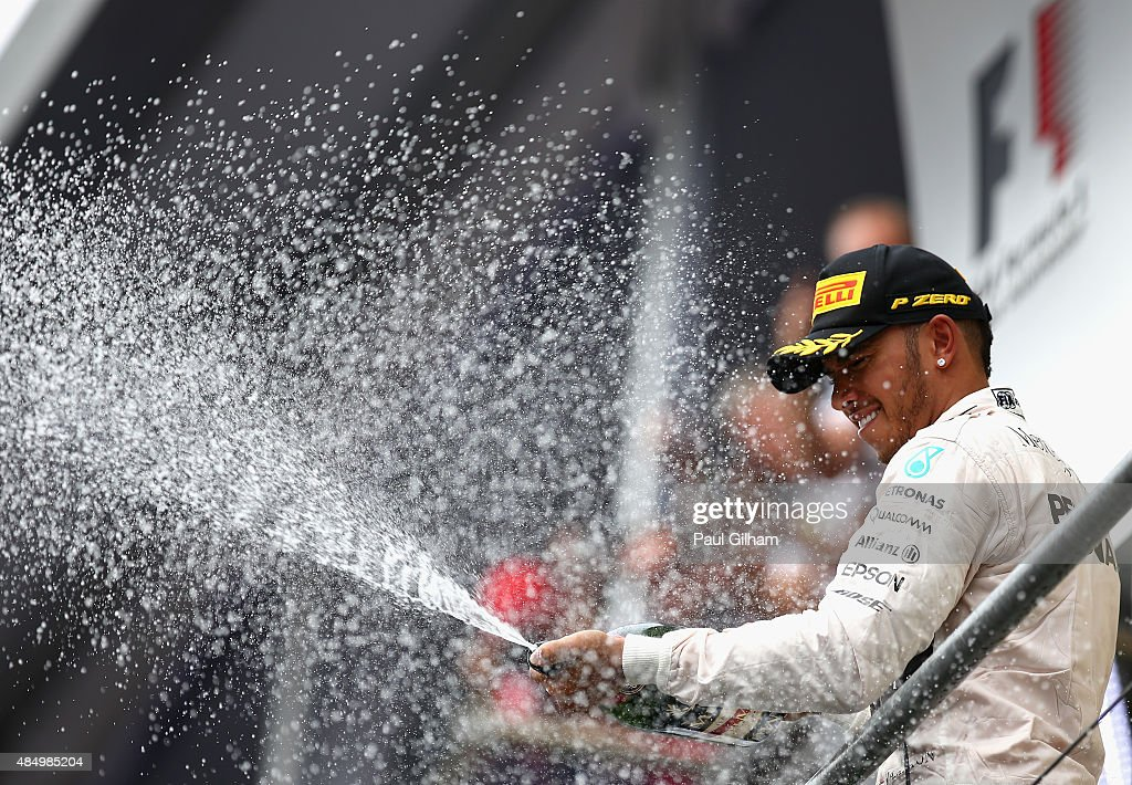 Lewis Hamilton of Great Britain and Mercedes GP celebrates on the podium after winning the Formula One Grand Prix of Belgium at Circuit de...