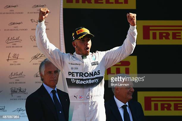 Lewis Hamilton of Great Britain and Mercedes GP celebrates on the podium after winning the Formula One Grand Prix of Italy at Autodromo di Monza on...
