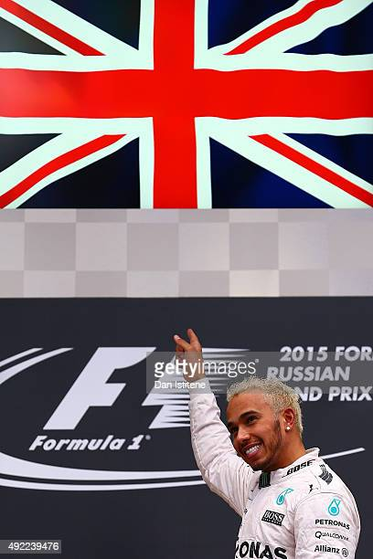 Lewis Hamilton of Great Britain and Mercedes GP celebrates on the podium after winning the Formula One Grand Prix of Russia at Sochi Autodrom on...