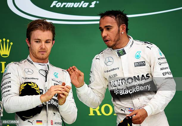 Lewis Hamilton of Great Britain and Mercedes GP celebrates on the podium next to Nico Rosberg of Germany and Mercedes GP after winning the United...
