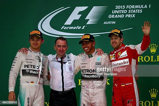 Lewis Hamilton of Great Britain and Mercedes GP celebrates on the podium next to Nico Rosberg of Germany and Mercedes GP Paddy Lowe Mercedes...