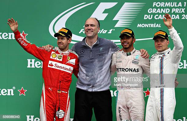 Lewis Hamilton of Great Britain and Mercedes GP celebrates on the podium with Sebastian Vettel of Germany and Ferrari and Valtteri Bottas of Finland...