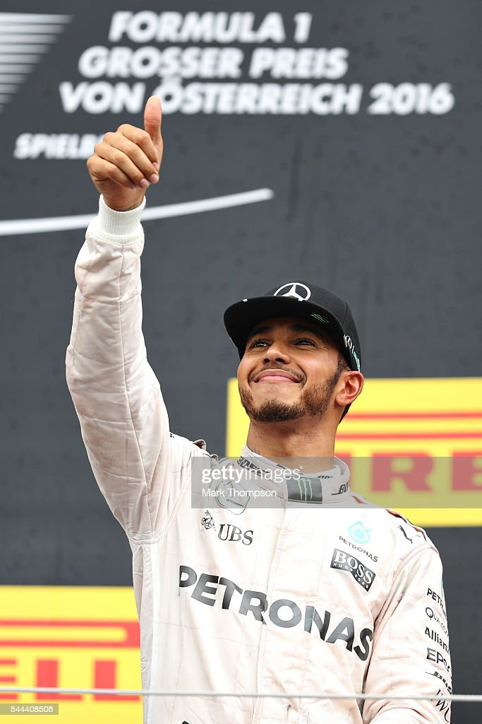 Lewis Hamilton of Great Britain and Mercedes GP celebrates on the podium during the Formula One Grand Prix of Austria at Red Bull Ring on July 3 2016...