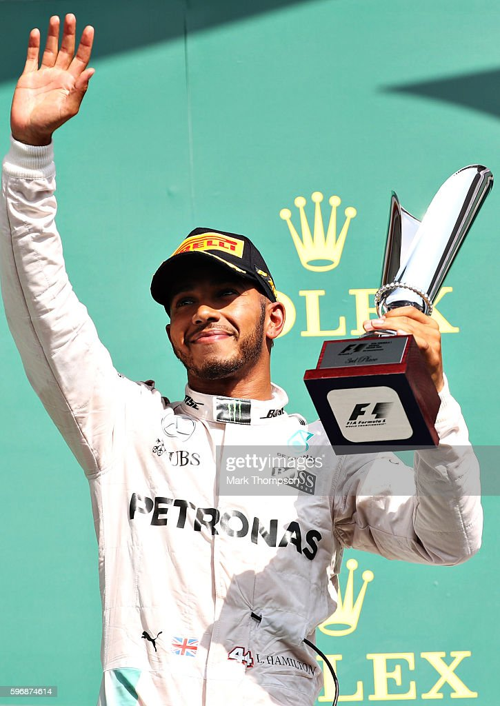 Lewis Hamilton of Great Britain and Mercedes GP celebrates on the podium during the Formula One Grand Prix of Belgium at Circuit de SpaFrancorchamps...