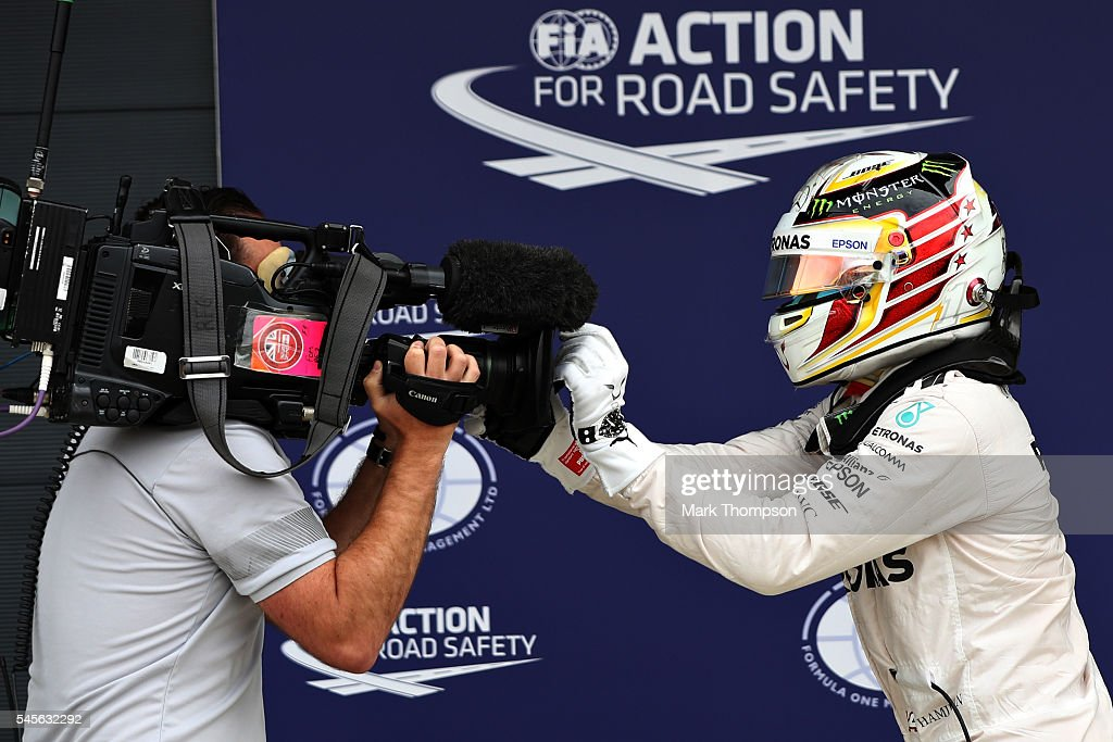 Lewis Hamilton of Great Britain and Mercedes GP celebrates qualifying on pole position in parc ferme during qualifying for the Formula One Grand Prix...