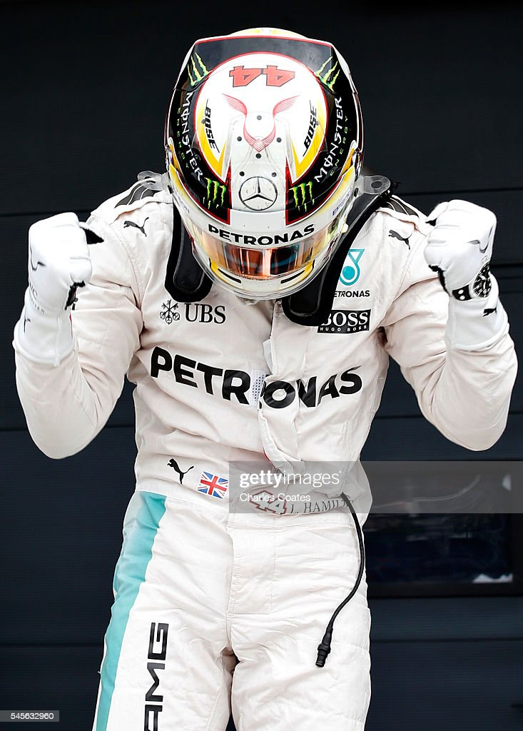 Lewis Hamilton of Great Britain and Mercedes GP celebrates qualifying in pole position in parc ferme during qualifying for the Formula One Grand Prix...