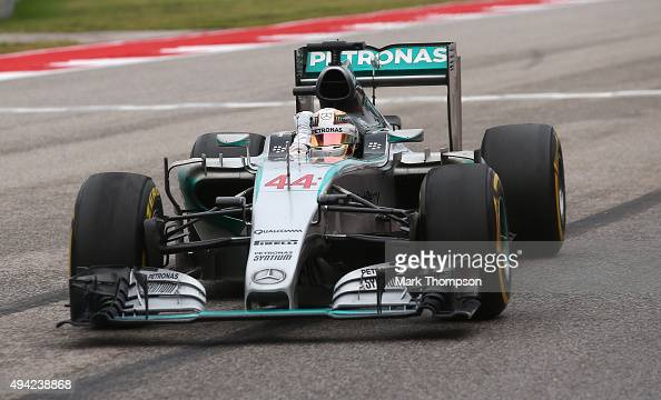 Lewis Hamilton of Great Britain and Mercedes GP celebrates winning the United States Formula One Grand Prix and the championship at Circuit of The...