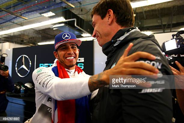 Lewis Hamilton of Great Britain and Mercedes GP celebrates with Mercedes GP Executive Director Toto Wolff in the garage after winning the United...