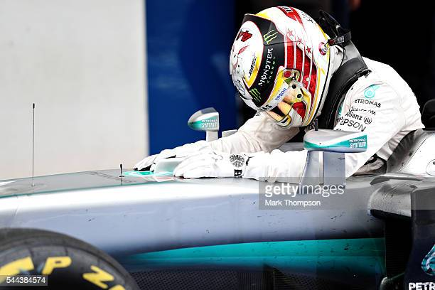 Lewis Hamilton of Great Britain and Mercedes GP celebrates with his car in parc ferme during the Formula One Grand Prix of Austria at Red Bull Ring...