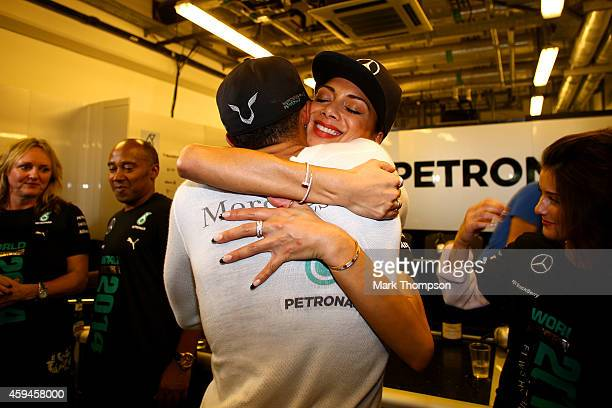 Lewis Hamilton of Great Britain and Mercedes GP celebrates with girlfriend Nicole Scherzinger after winning the World Championship after the Abu...