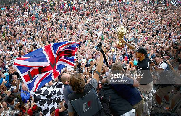 Lewis Hamilton of Great Britain and Mercedes GP celebrates with the fans after winning the Formula One Grand Prix of Great Britain at Silverstone...