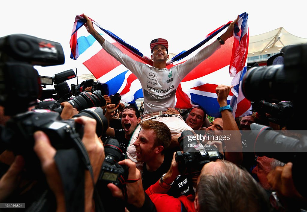 <a gi-track='captionPersonalityLinkClicked' href=/galleries/search?phrase=Lewis+Hamilton&family=editorial&specificpeople=586983 ng-click='$event.stopPropagation()'>Lewis Hamilton</a> of Great Britain and Mercedes GP celebrates with the team in the pit lane after winning the United States Formula One Grand Prix and the championship at Circuit of The Americas on October 25, 2015 in Austin, United States.