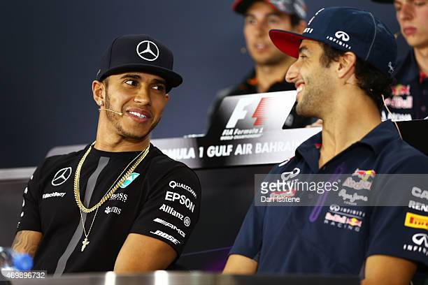 Lewis Hamilton of Great Britain and Mercedes GP chats with Daniel Ricciardo of Australia and Infiniti Red Bull Racing at the driver press conference...