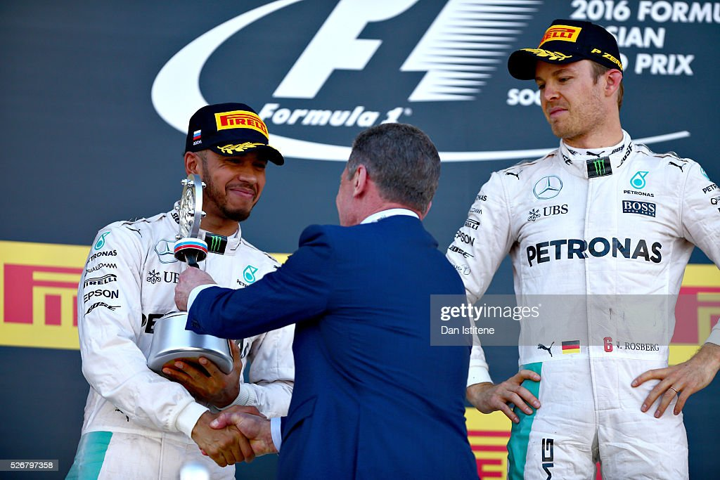 <a gi-track='captionPersonalityLinkClicked' href=/galleries/search?phrase=Lewis+Hamilton&family=editorial&specificpeople=586983 ng-click='$event.stopPropagation()'>Lewis Hamilton</a> of Great Britain and Mercedes GP collects his trophy for second from Dmitry Kozak, Deputy Prime Minister of Russia on the podium next to <a gi-track='captionPersonalityLinkClicked' href=/galleries/search?phrase=Nico+Rosberg&family=editorial&specificpeople=800808 ng-click='$event.stopPropagation()'>Nico Rosberg</a> of Germany and Mercedes GP during the Formula One Grand Prix of Russia at Sochi Autodrom on May 1, 2016 in Sochi, Russia.