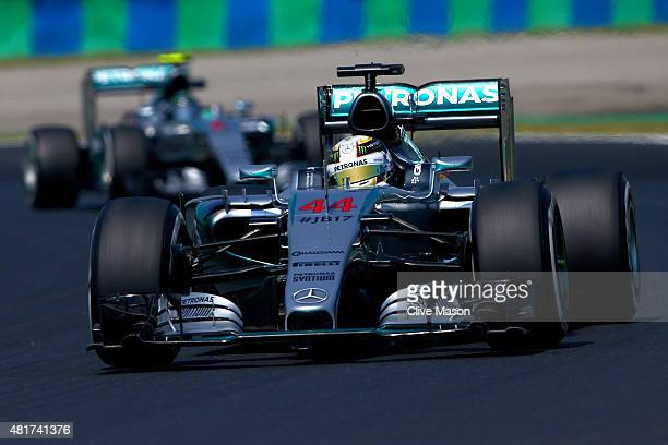 Lewis Hamilton of Great Britain and Mercedes GP drives ahead of Nico Rosberg of Germany and Mercedes GP during practice for the Formula One Grand...
