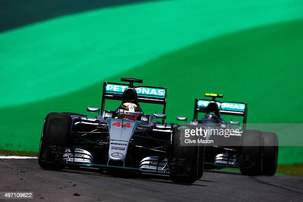 Lewis Hamilton of Great Britain and Mercedes GP drives ahead of Nico Rosberg of Germany and Mercedes GP during final practice for the Formula One...