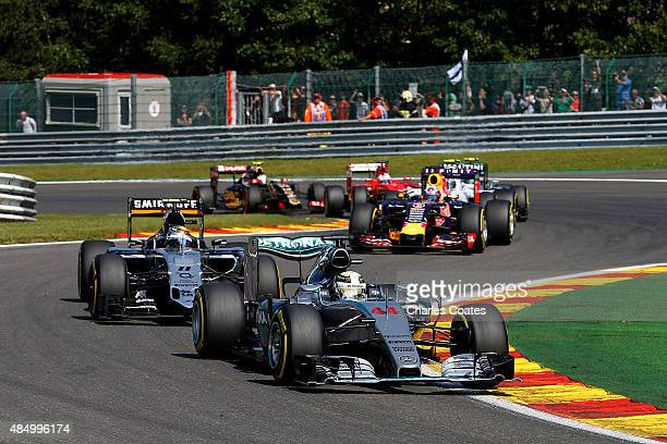 Lewis Hamilton of Great Britain and Mercedes GP drives ahead of Sergio Perez of Mexico and Force India during the Formula One Grand Prix of Belgium...