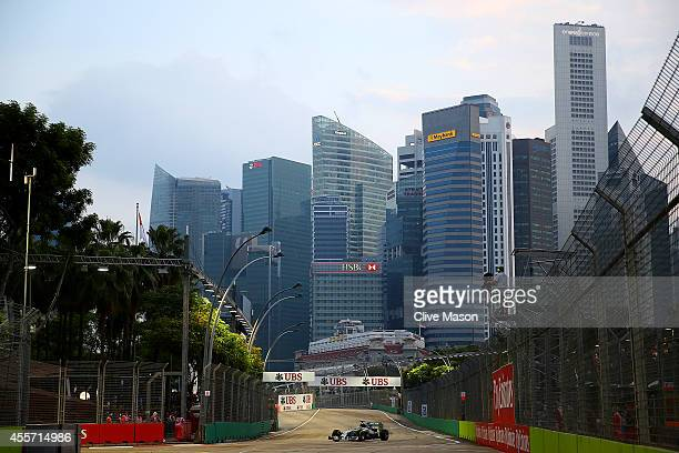 Lewis Hamilton of Great Britain and Mercedes GP drives during practice ahead of the Singapore Formula One Grand Prix at Marina Bay Street Circuit on...