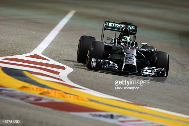 Lewis Hamilton of Great Britain and Mercedes GP drives during qualifying ahead of the Singapore Formula One Grand Prix at Marina Bay Street on...