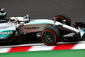 Lewis Hamilton of Great Britain and Mercedes GP drives during final practice for the Formula One Grand Prix of Japan at Suzuka Circuit on September...