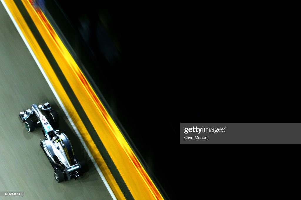 <a gi-track='captionPersonalityLinkClicked' href=/galleries/search?phrase=Lewis+Hamilton&family=editorial&specificpeople=586983 ng-click='$event.stopPropagation()'>Lewis Hamilton</a> of Great Britain and Mercedes GP drives during practice for the Singapore Formula One Grand Prix at Marina Bay Street Circuit on September 20, 2013 in Singapore, Singapore.
