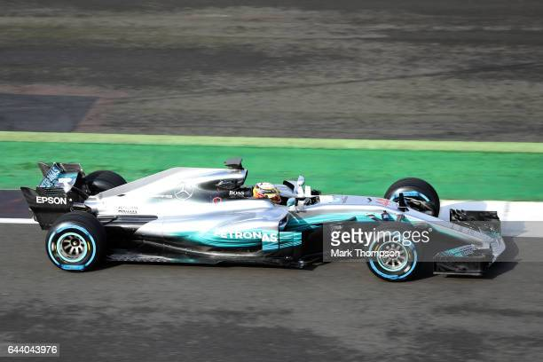 Lewis Hamilton of Great Britain and Mercedes GP drives during the launch of the Mercedes formula one team's 2017 car the W08 at Silverstone Circuit...