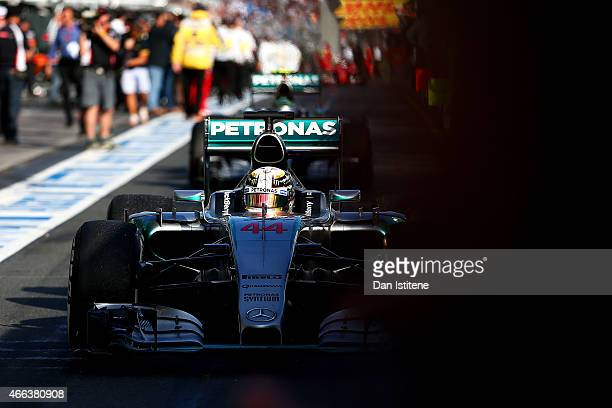 Lewis Hamilton of Great Britain and Mercedes GP drives into Parc Ferme after winning the Australian Formula One Grand Prix at Albert Park on March 15...