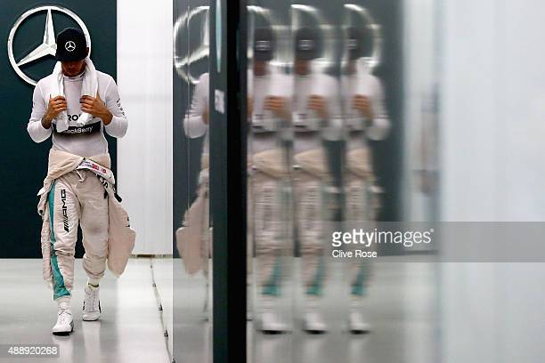 Lewis Hamilton of Great Britain and Mercedes GP exits the garage after practice for the Formula One Grand Prix of Singapore at Marina Bay Street...