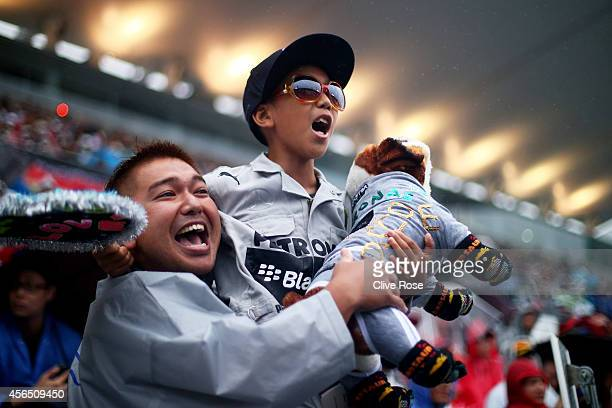 Lewis Hamilton of Great Britain and Mercedes GP fans cheer their hero ahead of the Japanese Formula One Grand Prix at Suzuka Circuit on October 2...