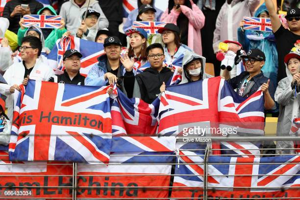 Lewis Hamilton of Great Britain and Mercedes GP fans in the grandstand during the Formula One Grand Prix of China at Shanghai International Circuit...