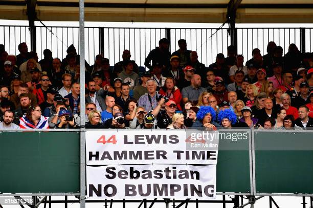 Lewis Hamilton of Great Britain and Mercedes GP fans with a sign referencing the incident between Sebastian Vettel of Germany and Ferrari and Lewis...