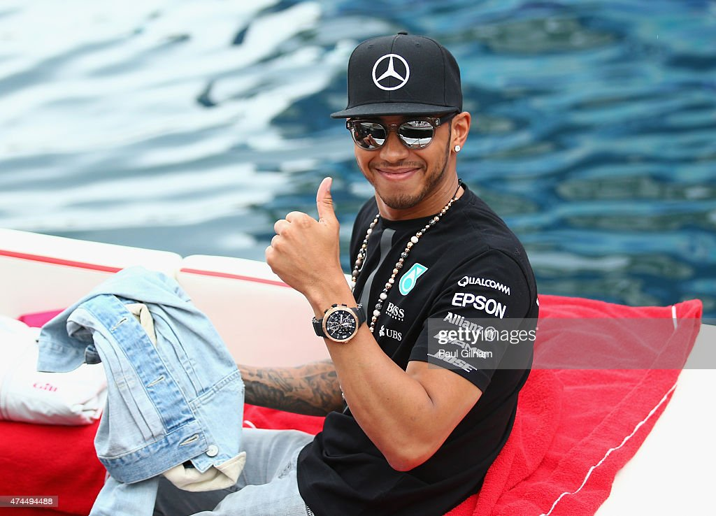 Lewis Hamilton of Great Britain and Mercedes GP gives a thumbs up as he leaves the circuit on a boat after qualifying for the Monaco Formula One Grand Prix at Circuit de Monaco on May 23, 2015 in Monte-Carlo, Monaco.
