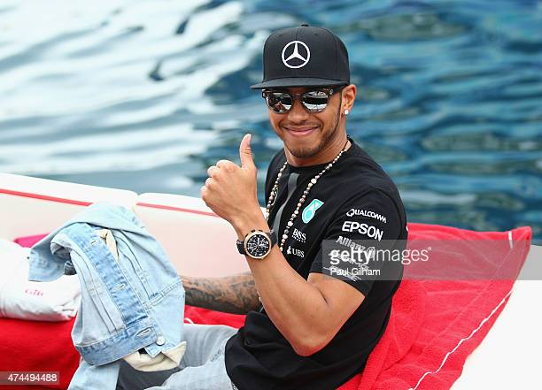 Lewis Hamilton of Great Britain and Mercedes GP gives a thumbs up as he leaves the circuit on a boat after qualifying for the Monaco Formula One...