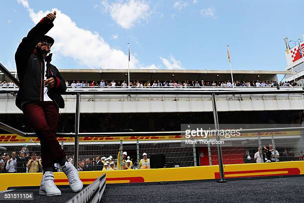 Lewis Hamilton of Great Britain and Mercedes GP gives the crowd a thumbs up on the drivers parade ahead of the Spanish Formula One Grand Prix at...