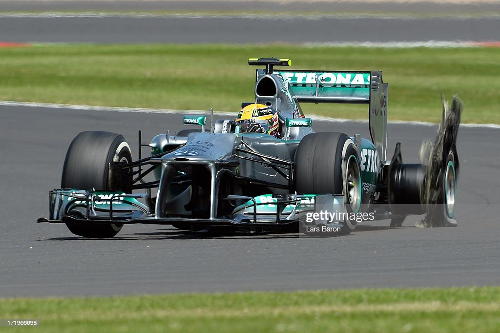 <a gi-track='captionPersonalityLinkClicked' href=/galleries/search?phrase=Lewis+Hamilton&family=editorial&specificpeople=586983 ng-click='$event.stopPropagation()'>Lewis Hamilton</a> of Great Britain and Mercedes GP has a left rear tyre failure during the British Formula One Grand Prix at Silverstone Circuit on June 30, 2013 in Northampton, England.