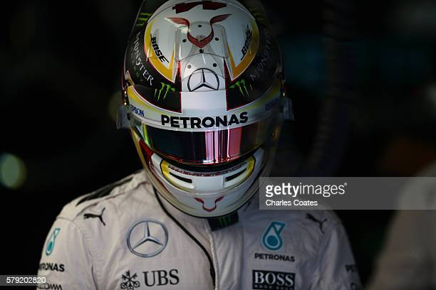 Lewis Hamilton of Great Britain and Mercedes GP in the garage during final practice for the Formula One Grand Prix of Hungary at Hungaroring on July...