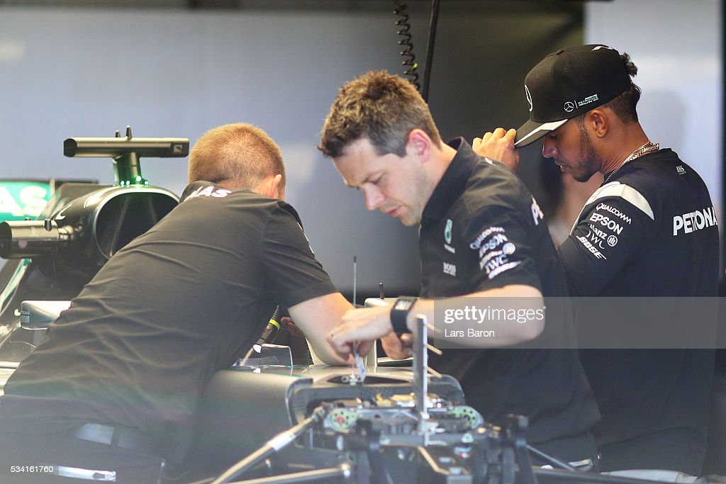 <a gi-track='captionPersonalityLinkClicked' href=/galleries/search?phrase=Lewis+Hamilton&family=editorial&specificpeople=586983 ng-click='$event.stopPropagation()'>Lewis Hamilton</a> of Great Britain and Mercedes GP in the garage while the Mercedes GP team work on his car during previews to the Monaco Formula One Grand Prix at Circuit de Monaco on May 25, 2016 in Monte-Carlo, Monaco.