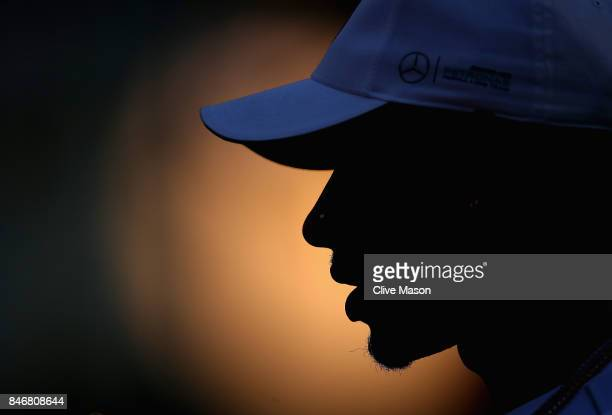 Lewis Hamilton of Great Britain and Mercedes GP in the Paddock during previews ahead of the Formula One Grand Prix of Singapore at Marina Bay Street...