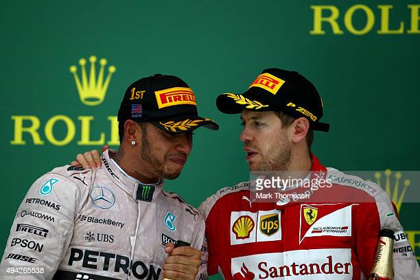 Lewis Hamilton of Great Britain and Mercedes GP is congratulated by Sebastian Vettel of Germany and Ferrari after winning the United States Formula...