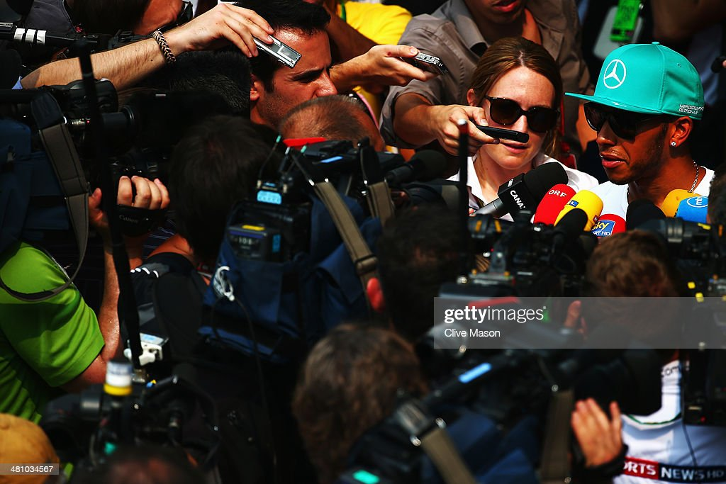 <a gi-track='captionPersonalityLinkClicked' href=/galleries/search?phrase=Lewis+Hamilton&family=editorial&specificpeople=586983 ng-click='$event.stopPropagation()'>Lewis Hamilton</a> of Great Britain and Mercedes GP is interviewed by the media following practice for the Malaysia Formula One Grand Prix at the Sepang Circuit on March 28, 2014 in Kuala Lumpur, Malaysia.