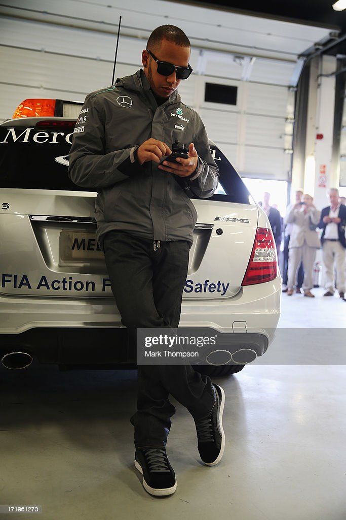 Lewis Hamilton of Great Britain and Mercedes GP is seen in the F.I.A. garage before attending the drivers parade during the British Formula One Grand Prix at Silverstone Circuit on June 30, 2013 in Northampton, England.