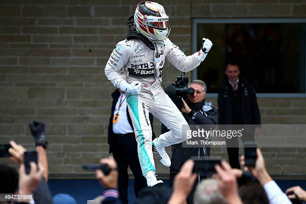 Lewis Hamilton of Great Britain and Mercedes GP jumps in the air in Parc Ferme after winning the United States Formula One Grand Prix and the...