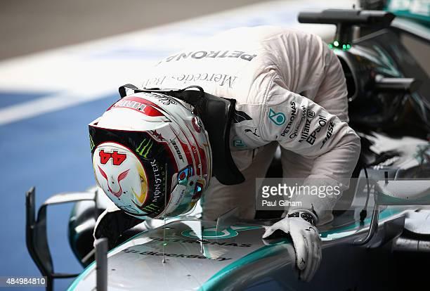 Lewis Hamilton of Great Britain and Mercedes GP kisses the car as he celebrates winning the Formula One Grand Prix of Belgium at Circuit de...